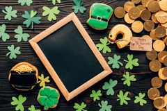 Top view of empty board with gingerbread and coins on table, st patricks day concept stock photos