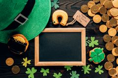 Top view of empty board with gingerbread and shamrock on table, st patricks day concept royalty free stock photo