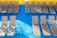 Top view of empty chairs in sunbathing area Royalty Free Stock Image