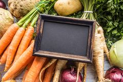 Top of view empty chalkboard on fresh vegetables royalty free stock image
