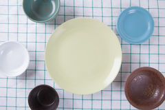 Top view of empty colorful plate put on cloth table. With space for copy Stock Images