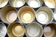 Top view of empty food tins. The cans are in rows filling the frame royalty free stock photography