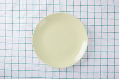 Top view of empty green plate put on cloth table. With space for copy Royalty Free Stock Images