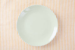 Top view of empty green plate put on cloth table. Royalty Free Stock Photos