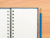 Top view empty notebook and blue pencil Stock Images