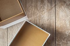 Top view of empty open cardboard box on wooden background Stock Image