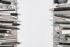 Top view of empty paper sheet and various drawing tools and acce Stock Photo