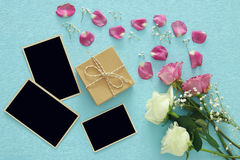 Top view of empty photo frames next roses Royalty Free Stock Image