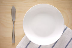 Top view of an empty plate on kitchen table Royalty Free Stock Photos