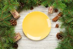 Top view. Empty plate round ceramic on wooden christmas background. holiday dinner dish concept with new year decor.  stock photography