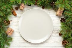 Top view. Empty plate round ceramic on wooden christmas background. holiday dinner dish concept with new year decor.  royalty free stock images