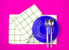Top view of empty  red dish and towel on vibrant color backgroun Royalty Free Stock Photo