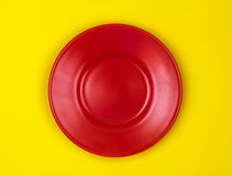 Top view of empty red dish vibrant color background Stock Images