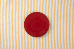 Top view of empty red plate put on cloth table. With space for copy Royalty Free Stock Images