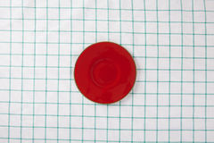 Top view of empty red plate put on cloth table Royalty Free Stock Photography