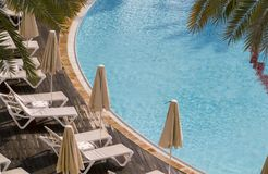 Top view of empty swimming pool of luxury hotel. In afternoon.Conceptual image for vacation,travel and SPA Stock Photo