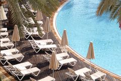 Top view of empty swimming pool of luxury hotel. In afternoon.Conceptual image for vacation,travel and SPA Royalty Free Stock Photo