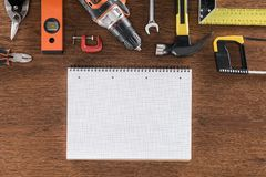 Top view of empty textbook near arranged various tools on wooden. Table stock photos