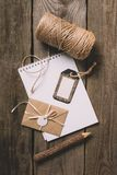 Top view of empty textbook tree pencil tag wrapped letter and beige string on wooden. Background stock images