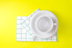 Top view of empty white coffee or tea cup with towel on vibrant Royalty Free Stock Photo