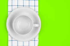 Top view of empty white coffee or tea cup with towel on vibrant Royalty Free Stock Photography