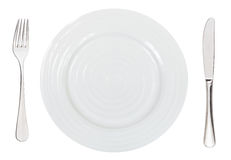 Top view of empty white dinner plate with cutlery Royalty Free Stock Photo