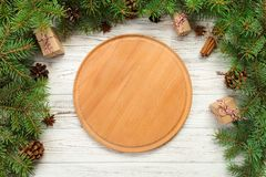 Top view. Empty wood round plate on wooden christmas background. holiday dinner dish concept with new year decor.  stock images