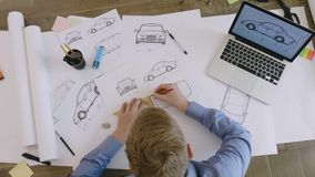 Top view engineer working on a car design sketch. Engineer working on a car design sketch stock footage stock video