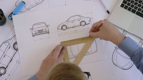 Top view engineer working on a car design sketch. Engineer working on a car design sketch stock footage stock footage
