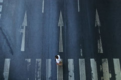 Top view of eople crossing street on crosswalk.  stock photography