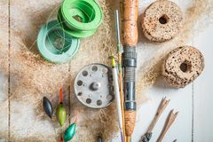 Top view of equipment for angler with rods and hooks. Retro style royalty free stock photos