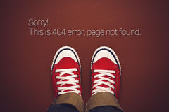 Top View of 404 Error, Page Not Found. Person in Red Sneakers Standing on Brown Background with Internet Error Message stock photo