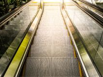 Top view of escalators. Sun light from outside Stock Photography