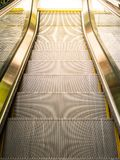 Top view of escalators. Sun light from outside Royalty Free Stock Photography
