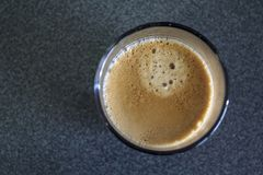 Espresso coffee with foam. Top view of Espresso coffee with foam royalty free stock images