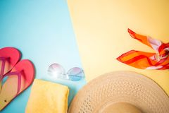 Beach accessories on yellow blue background royalty free stock photography