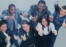 Top view of business people with their hands together Royalty Free Stock Image