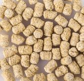 Top view of extruded wheat bran pellets.  Royalty Free Stock Images