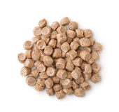 Top view of extruded wheat bran pellets Royalty Free Stock Photos