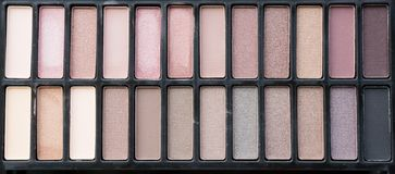 Top view of eye shadow earth tone color. Cosmetic background stock image