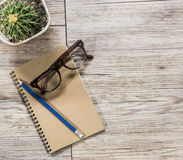 Top view of eyeglasses and pencil on a notebook Stock Photography