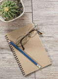 Top view of eyeglasses and pencil on a notebook Royalty Free Stock Photography