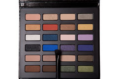Top view of eyeshadow palette with makeup brush Stock Photography