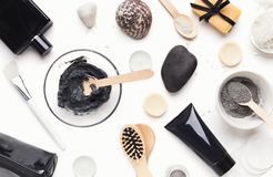 Top view of facial clay emulsion on white table. With spa products stock photo