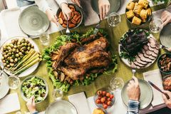Thanksgiving dinner. Top view of family having holiday dinner with turkey on thanksgiving Royalty Free Stock Photo