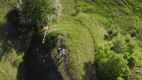 Top view of a family plays with a kite on nature