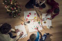 Top view of a family with two kids and a baby making Christmas d Royalty Free Stock Image