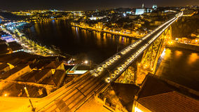 Top view famous Dom Luis I Bridge and Douro river at night time in Porto, Portugal. Royalty Free Stock Photos