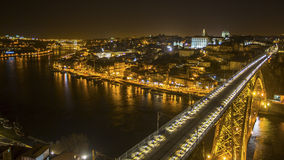 Top view famous Dom Luis I Bridge and Douro river at night time in Porto, Portugal. Stock Images