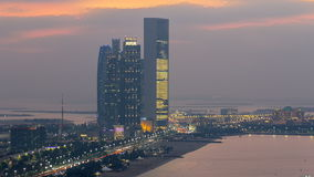 Top view of famous towers buildings in Abu Dhabi day to night timelapse. stock video